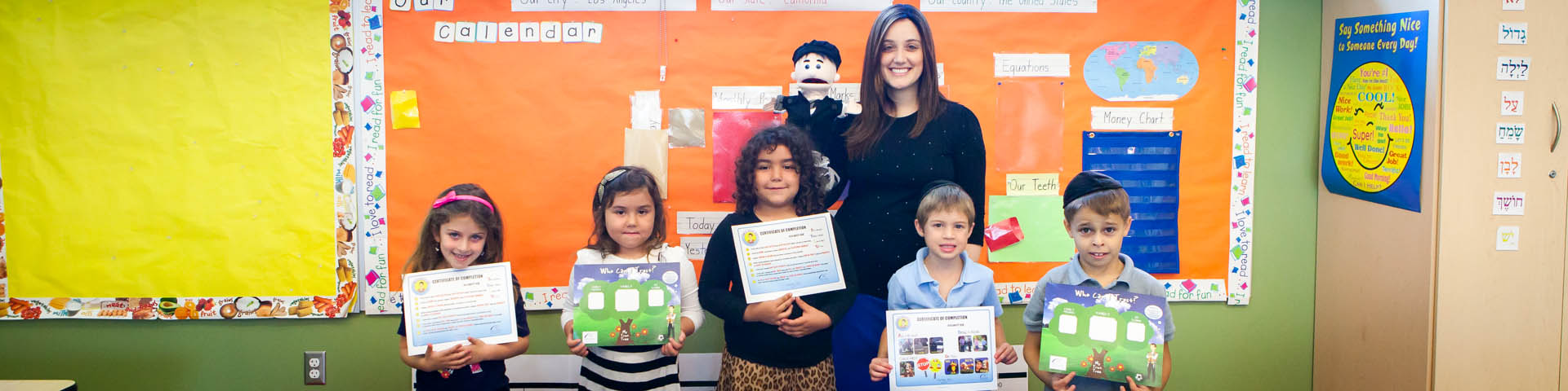 Safety Kid grads with teacher