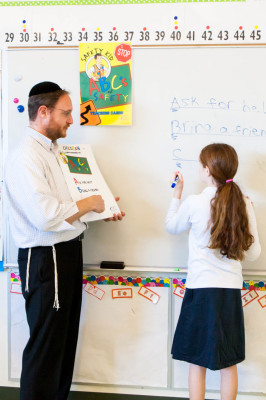 Yair Cohn with student at whiteboard