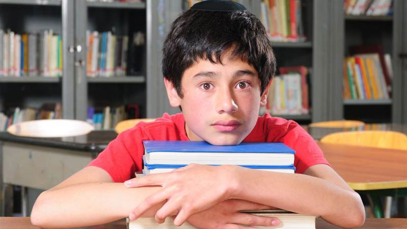 Worried boy in library